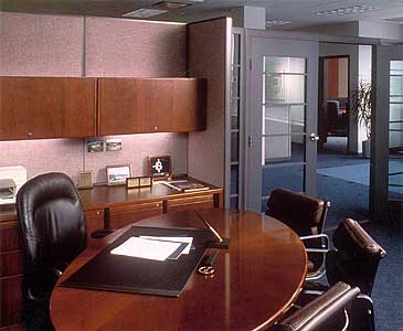 Chairman's office is an open workstation like every other officer, reflecting an attitude of equality.